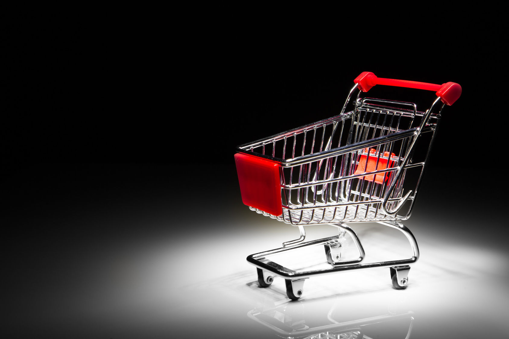 shopping cart on black background